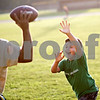 Beck Diefenbach  -  bdiefenbach@daily-chronicle.com<br /> <br /> Vincent Cornejo, 9, tries to block a pass by his father Oscar while playing at Sycamore Park in Sycamore, Ill., on Thursday Sept. 10, 2009.