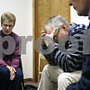 Beck Diefenbach  -  bdiefenbach@daily-chronicle.com<br /> <br /> Pastor Dean Pierce, right, reflects as Linda Abel, of DeKalb, leads the Sweet Hour of Prayer group session at Wesleyan Church of DeKalb in DeKalb, Ill., on Wednesday Jan. 14, 2008.