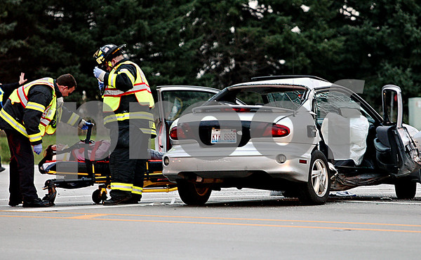 Rob Winner – rwinnner@daily-chronicle.com<br /> Emergency personnel remove an injured person from a vehicle that was involved in an accident at the intersection of Peace Road and Lincoln Highway/Route 38 on Friday in DeKalb.<br /> 11/13/2009