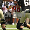 Beck Diefenbach – bdiefenbach@daily-chronicle.com<br /> Northern Illinois' D.J. Pirkle (98) battles Purdue's offensive line during the fourth quarter of the game in West Lafayette, Ind., on Saturday Sept. 19, 2009. NIU defeated Purdue 28 to 21.