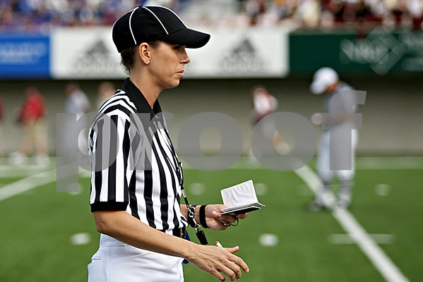 Rob Winner – rwinner@daily-chronicle.com<br /> Sarah Thomas jots down some notes during Saturday's Northern Illinois-Idaho game at Huskie Stadium.<br /> 09/26/2009