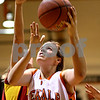 Beck Diefenbach  -  bdiefenbach@daily-chronicle.com<br /> <br /> DeKalb's Kelli Gerace (21) shoots for two points during the fourth quarter of the game against Batavia at DeKalb High School in DeKalb, Ill., on Tuesday Dec. 8, 2009. DeKalb defeated Batavia 33 to 21.