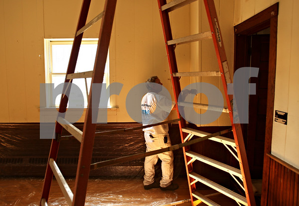 Beck Diefenbach  -  bdiefenbach@daily-chronicle.com<br /> <br /> Dan Griffith, of Dan's Custom Painting, begins a coat of white paints inside the theater at Conexión Comunidad as part of the city-wide United Way event, Day of Caring, in DeKalb, Ill., on Thursday Sept. 10, 2009.