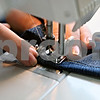 Rob Winner – rwinner@daily-chronicle.com<br /> Jody Quinn works on hemming a pair of pants at RB Designs on Tuesday.<br /> 09/29/2009