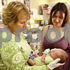 Rob Winner –  rwinner@daily-chronicle.com<br /> Judy Bergsmith (left) holds Suzi Leigh's newborn son Jacob recently at Bergsmith's new business in DeKalb which is named Express Yourself.<br /> 09/17/2009