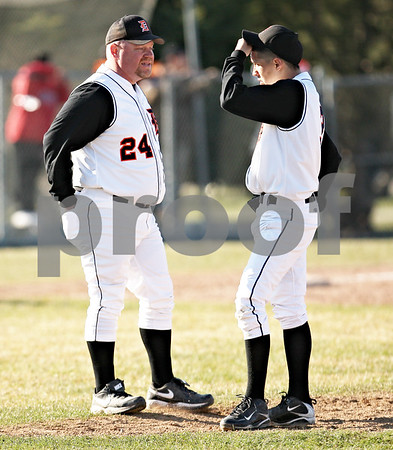 Beck Diefenbach  -  bdiefenbach@daily-chronicle.com<br /> <br /> DeKab head coach Justin Keck talks with pitcher Alex Jaquez before taking him out of the game during the third inning of the game against Batavia at DeKalb High School in DeKalb, Ill., on Wednesday April 15, 2009.