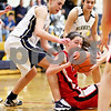 Beck Diefenbach  -  bdiefenbach@daily-chronicle.com<br /> <br /> Earlville-Leland's Morgan Musich (11) tries to get rid of the ball during the first quarter of the game against Hiawatha at Hiawatha High School in Kirkland, Ill., on Monday Dec. 14, 2009.