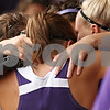 Beck Diefenbach  -  bdiefenbach@daily-chronicle.com<br /> <br /> Dixon softball players embrace after their final game of the season is ended early due to thunderstorms at Rochelle High School in Rochelle, Ill., on Tuesday May 26, 2009.