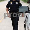 Rob Winner – rwinner@daily-chronicle.com<br /> Sgt. Gary Dumdie, of the DeKalb County Sheriff's Office, returns to his vehicle after pulling over a motorist for a driving violation in Sycamore on Friday afternoon.<br /> 07/03/2009