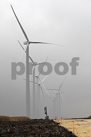 Rob Winner – rwinner@daily-chronicle.com<br /> <br /> Numerous wind turbines, which stand at 398 feet when the blades are at the apex, have been raised in the past few months in southwestern DeKalb county.<br /> <br /> 10/15/2009