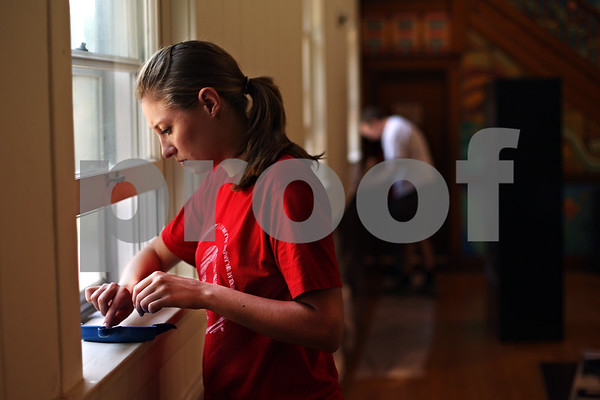 Beck Diefenbach  -  bdiefenbach@daily-chronicle.com<br /> <br /> Tara Hefter, of DeKalb, cleans out a window sill with the rest of her team from Target inside the theater at Conexión Comunidad as part of the city-wide United Way event, Day of Caring, in DeKalb, Ill., on Thursday Sept. 10, 2009.