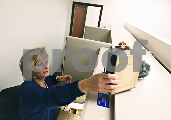 "Beck Diefenbach  -  bdiefenbach@daily-chronicle.com<br /> <br /> Staff nurse Ellen Corr places her personal items on the shelf above her desk as she moves into her new office space at the new Community Outreach Building at 2500 N. Annie Glidden Road in DeKalb, Ill., on Tuesday Jan. 13, 2008. ""It's great,"" Corr said. ""Everything is huge and new."""