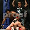 Beck Diefenbach  -  bdiefenbach@daily-chronicle.com<br /> <br /> Steven Kick (bottom), 18, of Sandwich, Ill., reacts after tapping-out in his fight against Mark Mack (left) during Power Fights 14, an amateur cage-fighting mixed-martial arts event at the Timber Creek Inn and Suites, in Sandwich, on Saturday Oct. 21, 2009.