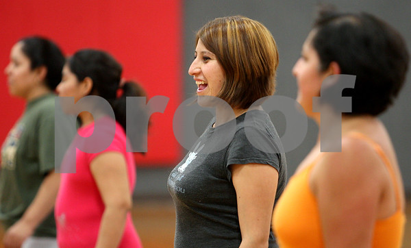 Rob Winner – rwinner@daily-chronicle.com<br /> Margarita Gonzalez enjoys herself during an excercise program specifically for minorities at Haish Gym in DeKalb on Tuesday night.<br /> 06/30/2009