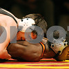 Rob Winner – rwinner@daily-chronicle.com<br /> Rob Winner – rwinner@kcchronicle.com<br /> Batavia's Logan Arlis (top) holds down DeKalb's David Williams during their match on Thursday night in Batavia.<br /> 12/03/2009 <br /> 125 lbs.<br /> Arlis wins