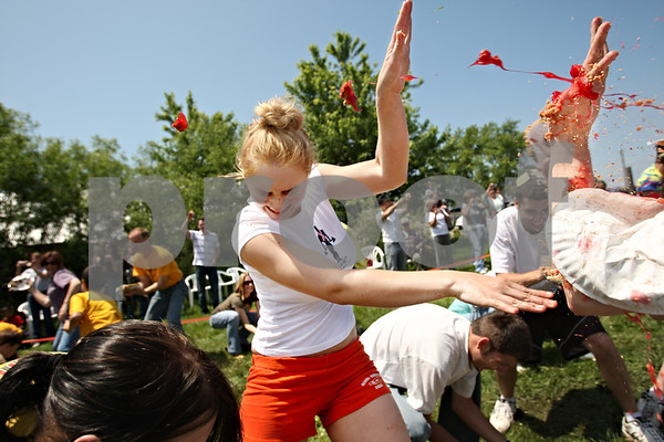 Beck Diefenbach  -  bdiefenbach@daily-chronicle.com<br /> <br /> Sarah Bradley, of Genoa, tries to block fragments of pie from hitting her during the world's largest pie fight in Genoa, Ill., on Saturday June 13, 2009. Over 200 people participated.