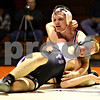Beck Diefenbach  -  bdiefenbach@daily-chronicle.com<br /> <br /> Kaneland's Kyle Davidson (bottom) is held down by DeKalb's Dalton Watie during the 152-pound match at DeKalb High School in DeKalb, Ill., on  Friday Dec. 11, 2009. Watie defeated Davidson by a decision.