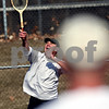 Beck Diefenbach – bdiefenbach@daily-chronicle.com<br /> <br /> Joel Plapp, of Sycamore, serves the ball to Bruce Kerbel, of Sycamore, during their first game of the year at Hopkins Park in DeKalb, Ill., on Thursday March 5, 2009.