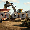 Beck Diefenbach  -  bdiefenbach@daily-chronicle.com<br /> <br /> Equipment operator Ray Stevens uses a front loader to bring yard waste to a grinder during one of the beginning stages of making compost at Waste Management Inc., near DeKalb, Ill., on Monday Sept. 5, 2009.