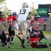 Rob Winner – rwinner@daily-chronicle.com<br /> Idaho's Bobby Cowan (13) has his punt blocked by Jordan Delegal (29) of NIU in the fourth quarter which eventually set up a Huskie touchdown and brought NIU within three. <br /> 09/26/2009