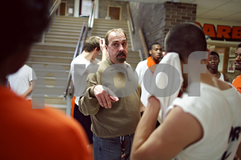 Beck Diefenbach – bdiefenbach@daily-chronicle.com<br /> <br /> DeKalb High School boys track coach Tim Holt talks with his runners during practice at DeKalb High School in DeKalb, Ill., on Tuesday March 10, 2009.