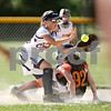 Beck Diefenbach  -  bdiefenbach@daily-chronicle.com<br /> <br /> DeKalb Hurricane's Morgan Witmer (92), right, beats the throw to Cary Crush's Devin Story during a 10-under game of Storm Dayz in Sycamore, Ill., on Friday June 26, 2009.