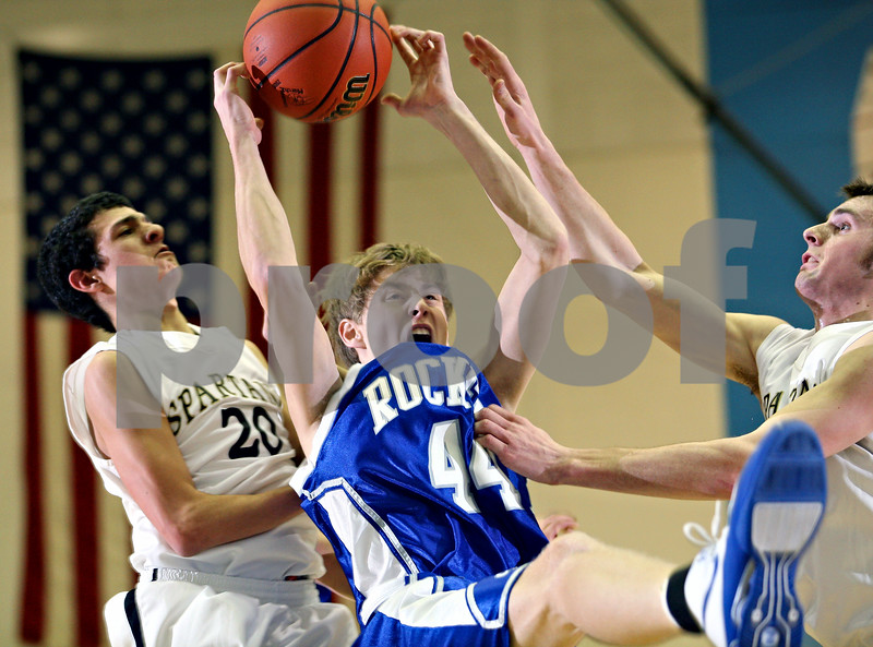 Beck Diefenbach – bdiefenbach@daily-chronicle.com<br /> <br /> From left, Sycamore's Joshua Reed (20), Central's Dan Berg (44) Sycamore's Kyle Szychlinski (40) battle for a rebound during the second quarter of the regional semi-final game at Central High School in Burlington, Ill., on Monday March 2 , 2009.