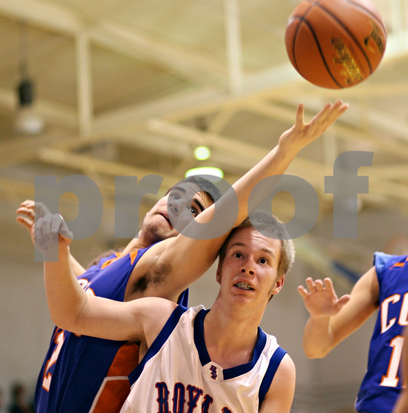 Beck Diefenbach  -  bdiefenbach@daily-chronicle.com<br /> <br /> Genoa-Kingston's Dominick (42, left) reaches for the ball over Hinckley-Big Rock's Jack Peters (44) during the second quarter of the game at H-BR High School in Hinckley, Ill., on Monday Dec. 21, 2009.