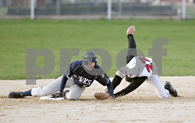 Beck Diefenbach  -  bdiefenbach@daily-chronicle.com<br /> <br /> Indian Creek's Ryan Fox (22) tags out Hiawatha's Jason Keneway (5) at second base during the fifth inning of the game at Indian Creek High School in Shabbona, Ill., on Monday April 20, 2009.