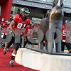 Rob Winner –  rwinner@daily-chronicle.com<br /> The Northern Illinois Huskies football team takes the field during Saturday's home opener against Western Illinois.<br /> 09/12/2009