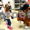 Rob Winner – rwinner@daily-chronicle.com<br /> Kelsey McGraw, 2 of Cortland, hugs Ozzie from the Kane County Cougars at the Midwest Museum of Natural History in Sycamore, Ill. on Wednesday December 30, 2009. Ozzie was at the museum for the naming of the museum's first ever mascot.