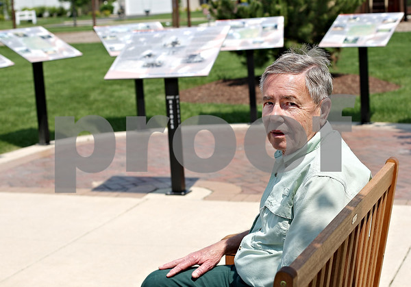 Beck Diefenbach  -  bdiefenbach@daily-chronicle.com<br /> <br /> Tom Warren sits by some of the many informational signs in his park, Finding Heros, in Somonauk, Ill., on Friday May 22, 2009.