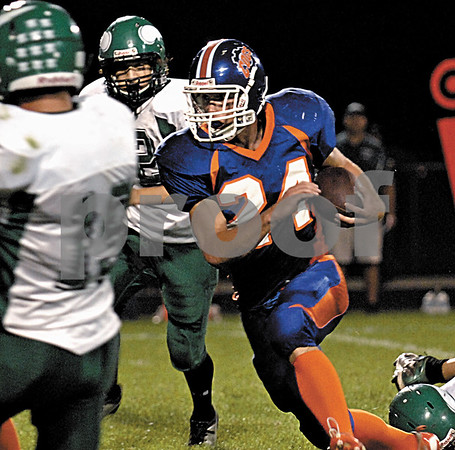Genoa High School's Robert Thurlby carries for yardage during 1st quarter action vs. North Boone on Friday, September 18, 2009 in Genoa.(Marcelle Bright/for the Chronicle)