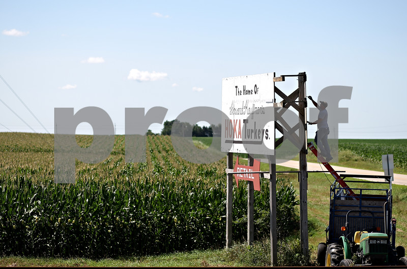 Beck Diefenbach  -  bdiefenbach@daily-chronicle.com<br /> <br /> Jim McAllister touches up the painted billboard for Ho-Ka Turkeys outside the farm near Waterman, Ill., on Wednesday July 29, 2009.