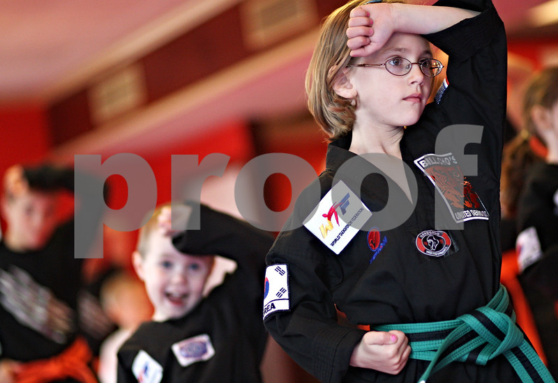 Beck Diefenbach  -  bdiefenbach@daily-chronicle.com<br /> <br /> Emilie Schramer during Taekwondo practice at Bill Cho's United Taekwondo in DeKalb, Ill., on Thursday April 2, 2009.