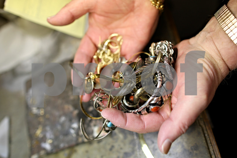 Beck Diefenbach – bdiefenbach@daily-chronicle.com<br /> <br /> Jeweler Gary Cook displays a handful of silver and gold he has purchased from customers at his store Golden Dreams in Sycamore, Ill., on Monday Feb. 23, 2009.