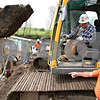 Beck Diefenbach  -  bdiefenbach@daily-chronicle.com<br /> <br /> Civil Construction excavator operator Joe Boryer, top, talks with foreman Ron Simpson during construction of a bridge on the Kishwuakee River north of Sycamore, Ill., on Tuesday May 5, 2009.