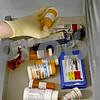 Rob Winner – rwinner@daily-chronicle.com<br /> Deputy Kelly King of the DeKalb County Sheriff's Office looks through a drawer for the proper medication to distribute to an inmate at the jail in Sycamore on Wednesday November 11, 2009.<br /> 11/11/2009