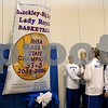 Rob Winner – rwinner@daily-chronicle.com<br /> Hinckley-Big Rock head coach Greg Burks (left) and members of the 2008-2009 IHSA Class 1A state championship team raise a banner during a recognition ceremony on Saturday December 19, 2009 in Hinckley, Ill.