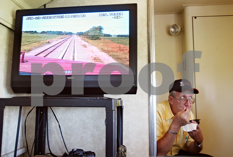 Beck Diefenbach  -  bdiefenbach@daily-chronicle.com<br /> <br /> Conductor for Union Pacific Gordon Bowe eats lunch as a monitor shows what is going on ahead of the Operation Lifesaver train on Tuesday June 23, 2009.