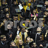 Northern Illinois University graduates toss their caps after the closing of commencement ceremonies at the Convocation Center on Sunday, December 12, 2009 in Dekalb, IL.  (Marcelle Bright/for the Chronicle)