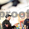 "Beck Diefenbach  -  bdiefenbach@daily-chronicle.com<br /> <br /> Craig French, of Plano, explains what type of bike he is interested in with bike mechanic Russ Stewart at North Central Cyclery in DeKalb, Ill., on Thursday March 27, 2009. ""People are looking for an alternative, for saving money and exercise,"" said store owner Tobie DePauw. """