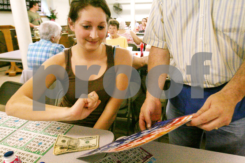 """Randi Stella – rstella@daily-chronicle.com<br /> <br /> Gina Troy, 22, wins a bingo at Bingo Night at St. Mary's school in DeKalb, Ill., Monday, June 8th, 2009.  """"This is my first time coming here, we always drive by and see the sign and wanted to come,"""" Troy said."""