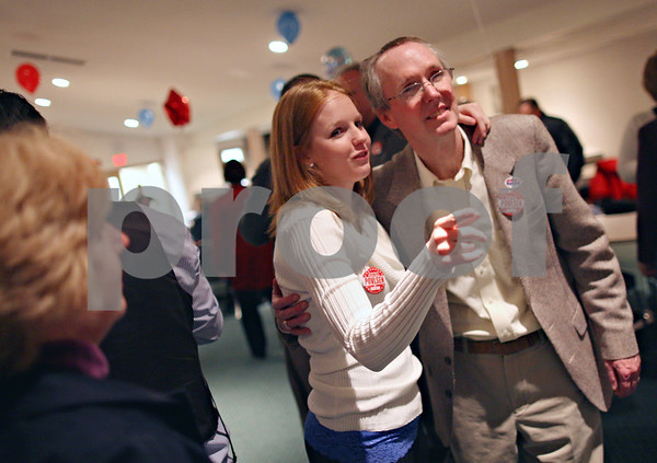 Beck Diefenbach  -  bdiefenbach@daily-chronicle.com<br /> <br /> Acting Mayor Kris Povlsen and his daughter Karissa inspect the election numbers at River Heights Golf Club in DeKalb, Ill., on Tuesday April 7, 2009.