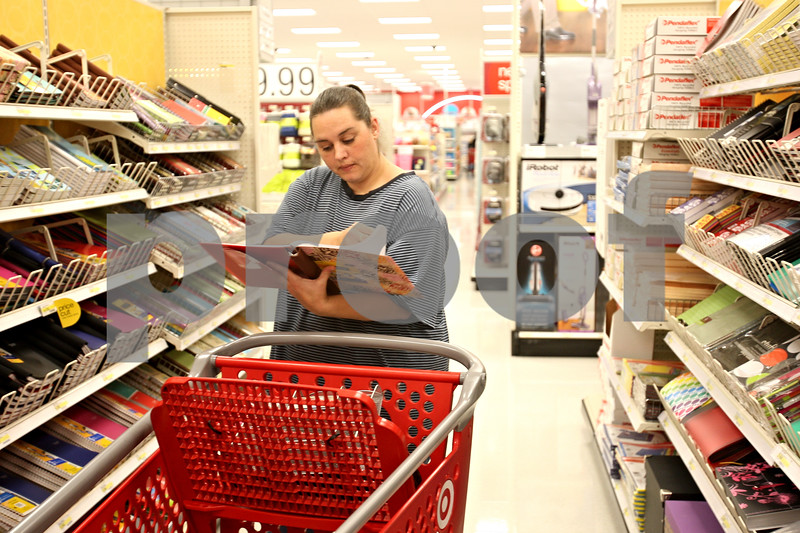 Beck Diefenbach  -  bdiefenbach@daily-chronicle.com<br /> <br /> Sasha Dennison, of DeKalb, looks through binders while shopping in the rebuilt Target Store in DeKalb, Ill., on Tuesday Oct. 6, 2009.