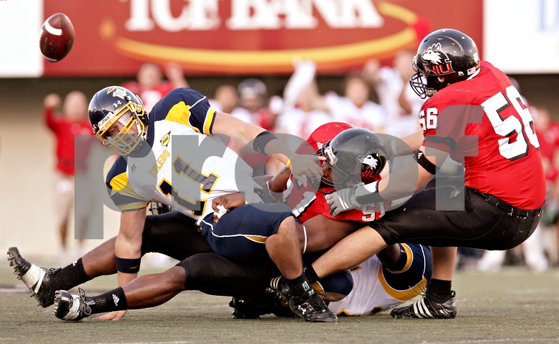 Rob Winner – Chronicle News Group<br /> Northern Illinois' Larry English (51, center) sacks Toledo quarterback Aaron Opelt (11, left) during the game at Huskie stadium at NIU in DeKalb, Ill., on October 18, 2008.