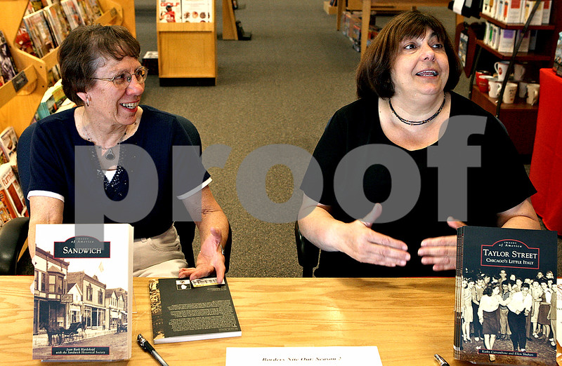 Rob Winner – rwinner@daily-chronicle.com<br /> Local authors Joan Hardekopf (left) and Kathy Catrambone talk with visitors during the Borders Nite Out event in DeKalb on July, 11. <br /> 07/11/2009