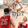Beck Diefenbach  -  bdiefenbach@daily-chronicle.com<br /> <br /> Somonauk's Brock Kartheiser (11, top) shoots the ball above Indian Creek's Steven Voris (30, right) and Seth Sander (25) during the third quarter of the game at Somonauk High School in Somonauk, Ill., on Friday Dec. 18, 2009.