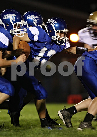 Beck Diefenbach  -  bdiefenbach@daily-chronicle.com<br /> <br /> Burlington Central Trevor McMillan (13) pushes his way through Sycamore defenders during the second quarter of the game at Burlington Central High School in Hampshire, Ill., on Friday Sept. 4, 2009.