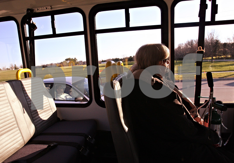 Beck Diefenbach  -  bdiefenbach@daily-chronicle.com<br /> <br /> Cathy Marlow, of DeKalb, gets a ride home on the Med-VAC bus following a therapy session on Tuesday Dec. 1, 2009.